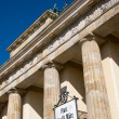 Brandenburger Tor and street sign — Stock Photo
