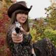 Girl with the gun in western style — Stock Photo