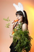 Bunny girl with carrots — Stock Photo