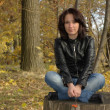 Stockfoto: Girl sitting on stump
