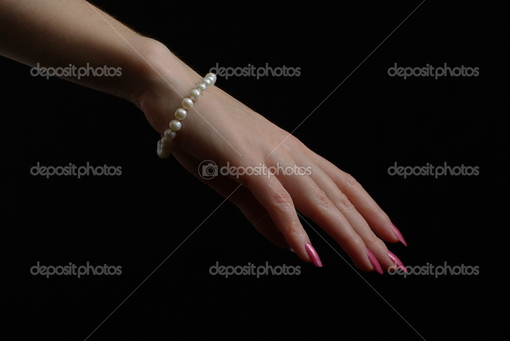 Hand with a pearl bracelet — Stock Photo #4441328