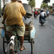 Tricycle rickshaw driver yogyakarta — Stock Photo