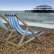 Brighton beach deckchairs west pier — Stock Photo