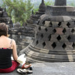 Royalty-Free Stock Photo: Tourist sketching borobudur temple indonesia