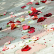 Petals of roses scattered on a floor — Stock Photo