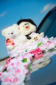 Small teddy plush on wedding — Stock Photo
