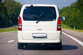 Minibus going on road. Advance on roads of Europe — Stock Photo