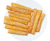 Sweet baking sticks on a white plate — Stock Photo