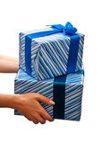 Presents in hands — Stock Photo