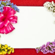 Greeting card with pink bow — Stock Photo