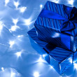 Stock Photo: Gifts boxes and garland