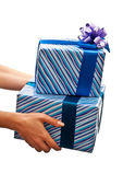Presents in womans hands — Stock Photo