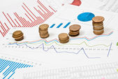 Coins and charts — Stock Photo