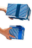 Two gifts in hands — Stockfoto