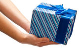 Blue present in man's hands — Stock Photo