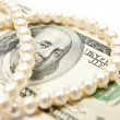 Pearls and dollars — Stock Photo