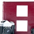 Retro camera and red album — Stock Photo