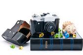 Camera and photo album — Stock Photo