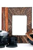 Camera and album — Stock Photo