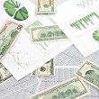Stock Photo: Dollars and charts