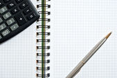 Notebook, ballpen and calculator — Stock Photo