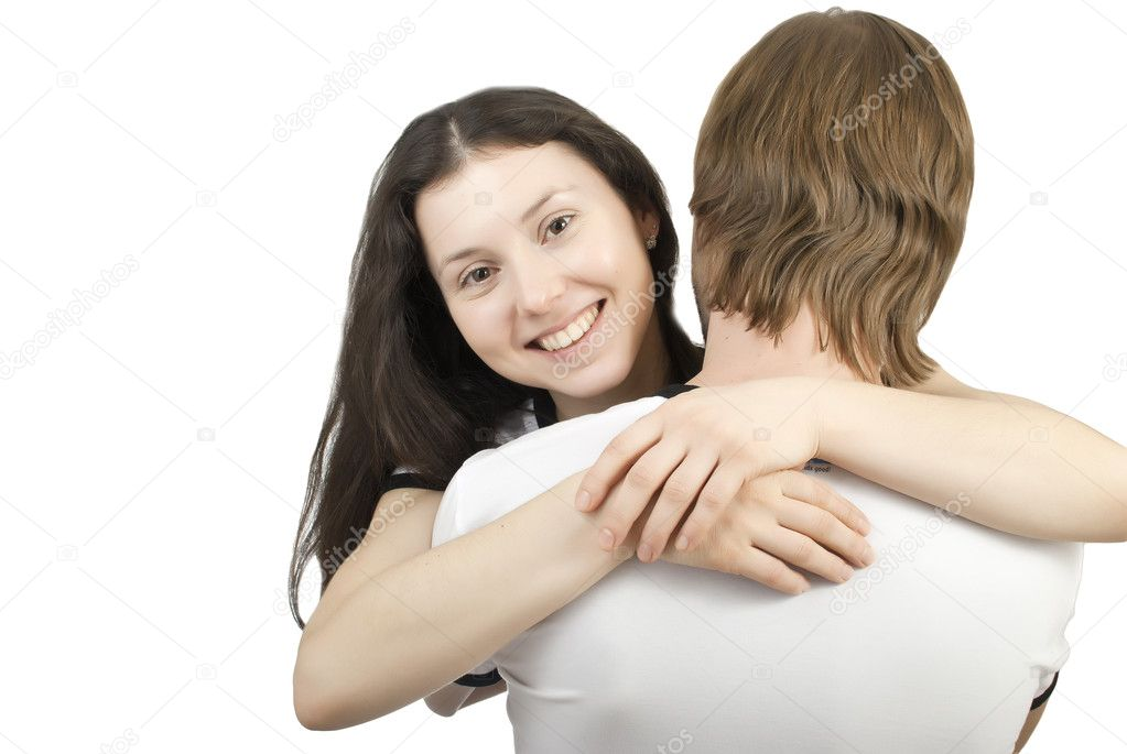 Beautiful young girl hugging her young man on a white background — Stock Photo #4745780