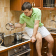Young handsome guy in the kitchen — Stock Photo