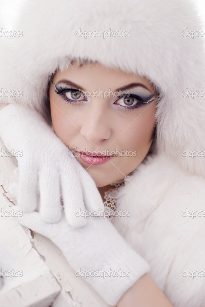 Beautiful girl in white gloves and white hat — Stock Photo #4858466