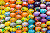 Wooden easter eggs background. — Stock Photo