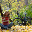 Happy girl with bike. — Stock Photo #4074695