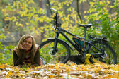 Beauty girl with bike. — Stock Photo