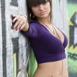 Young sexy girl in graffiti. — Stock Photo