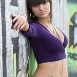 Young sexy girl in graffiti. — Stock Photo
