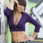 Young sexy girl in graffiti. — Stock Photo #4098361