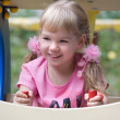 Cute little girl on outdoor playground. — Foto de stock #4098378