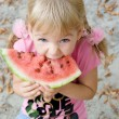Cute girl eating watermelon. — Stock Photo