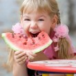 Cute girl eating watermelon. — Stock Photo #4098398