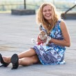 Girl with rabbit. - Stock Photo