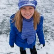 Smiling girl on ice skates. — Stockfoto #4146453
