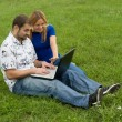 Stock Photo: Laptop business couple.