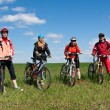 A group of four adults on bicycles in the countryside. — Stock Photo