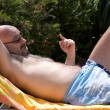 Man With Funny Expression Relaxing In The Garden — Stockfoto