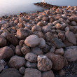 Stock Photo: Stones On The Beach At Dusk