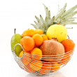 Fruit in vase on white background — Stock Photo #4542987