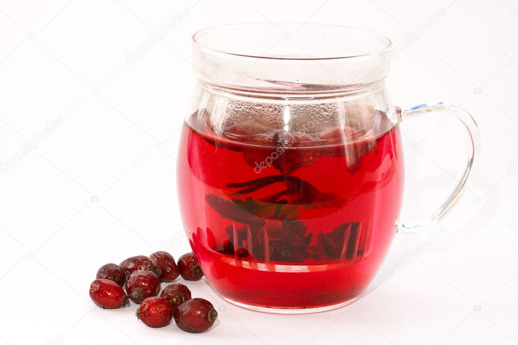 Rosehip tea in the teapot, isolated on a white background — Stock Photo #4727859