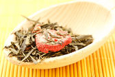 Green tea flavored with dried fruits — Stock Photo