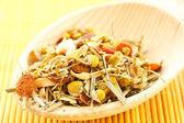 Chamomile tea and herbs flavored — Stock Photo