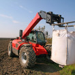 Stock Photo: Agricultural machinery with bag of weath seeds