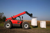 Agricultural machinery with bag of weath seeds — Stock Photo