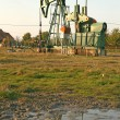 Oil wells with pollution — Stock Photo #4070250